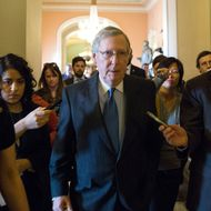 WASHINGTON, DC - DECEMBER 30: Senate Minority Leader Mitch McConnell (R-KY) walks with reporters on his way to a meeting with Republicans on Capitol Hill December 30, 2012 in Washington, DC. The House and Senate are both in session today to deal with the looming 'fiscal cliff.' issue. (Photo by Drew Angerer/Getty Images)