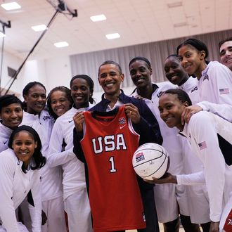 WASHINGTON, DC - JULY 16: U.S. President Barack Obama poses with the Olypmics-bound U.S. Women's National Basketball team after their victory over Brazil at the Verizon Center on July 16, 2012 in Washington, DC. (Photo by Leslie E. Kossoff-Pool/Getty Images)