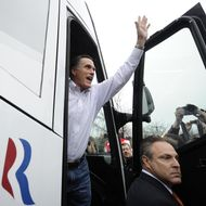 Republican presidential hopeful Mitt Romney waves getting on his campaign bus after paying a visit to Tommy's Country Ham House in Greenville, South Carolina, January 21, 2012. South Carolina holds its Republican primary on January 21, 2012.