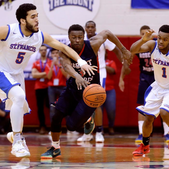 St. Francis forward Jalen Cannon (5) and guard Brent Jones (1) chase Robert Morris guard Kavon Stewart (3) during the first half of an NCAA college basketball game in the championship of the Northeast Conference tournament, Tuesday, March 10, 2015, in New York. (AP Photo/John Minchillo)
