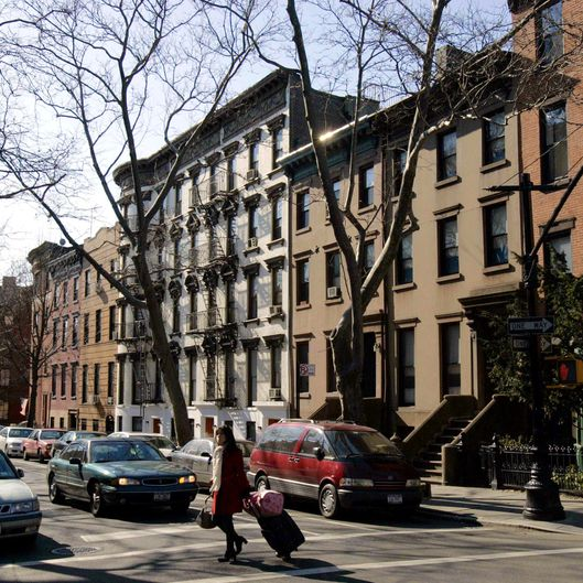 New York, UNITED STATES: TO GO WITH AFP STORY AFPLifestyle-US-property,sched-FEATURE Traditional brownstone buildings on Clinton Street 05 February 2007, in the Brooklyn borough of New York. A general development and revival trend is taking place in Brooklyn. AFP PHOTO/Stan HONDA (Photo credit should read STAN HONDA/AFP/Getty Images)