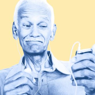 Senior man listening to mp3 player.