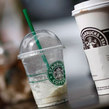 WEST PALM BEACH, FL- JULY 1:  Starbucks drinks sit on a table outside a store on the day that Starbucks Corp. said that it plans to close 600 company-operated stores in the United States July 1, 2008 in West Palm Beach, Florida. The company said the job cuts with the store closings represent about 7 percent of Starbucks' global workforce.  (Photo by Joe Raedle/Getty Images)