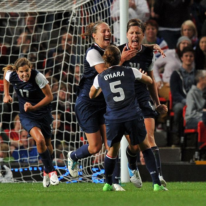 US forward Abby Wambach (L) celebrates scoring a penalty during the London 2012 Olympic women's football semi final match between the US and Canada at Old Trafford in Manchester, north-west England, on August 6, 2012.