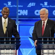 Former House speaker Newt Gingrich (R) and US businessman Herman Cain (L) laugh following an exchange during the Republican presidential debate on national security November 22, 2011.