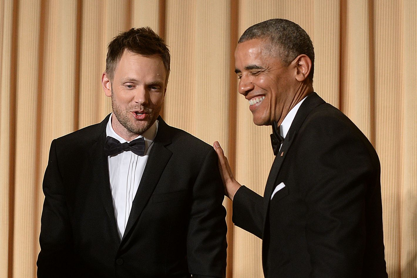 WASHINGTON, DC - MAY 3:  US President Barack Obama and comedian Joel McHale share a laugh at the annual White House Correspondent's Association Gala at the Washington Hilton hotel May 3, 2014 in Washington, D.C. The dinner is an annual event attended by journalists, politicians and celebrities. (Photo by Olivier Douliery-Pool/Getty Images)