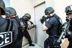 Police officers breaking down doors