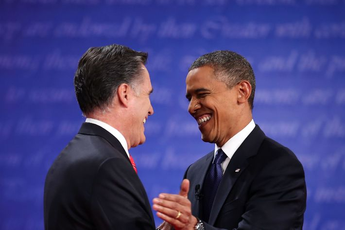 DENVER, CO - OCTOBER 03: Democratic presidential candidate, U.S. President Barack Obama (R) shakes hands with Republican presidential candidate, former Massachusetts Gov. Mitt Romney (L) during the Presidential Debate at the University of Denver on October 3, 2012 in Denver, Colorado. The first of four debates for the 2012 Election, three Presidential and one Vice Presidential, is moderated by PBS's Jim Lehrer and focuses on domestic issues: the economy, health care, and the role of government. (Photo by Chip Somodevilla/Getty Images)
