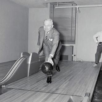 19 Apr 1948, Washington, DC, USA --- Original caption: Washington, D. C....Down The Alley With Truman. Harry S. Truman, the Missouri Southpaw, followed form today when he inaugurated the newly installed bowling alleys in the basement at the White House, and threw the first ball with his left arm, knocking down seven pins. The alleys were installed as a birthday gift to the president, but he likes pitching horseshoes better. --- Image by ? Bettmann/CORBIS