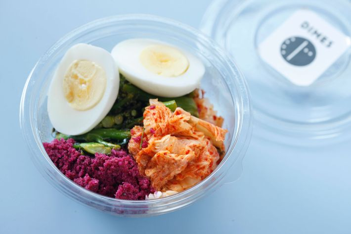 The kimchi bowl, with brown rice, broccolini, red-cabbage slaw, and a hard-boiled egg.