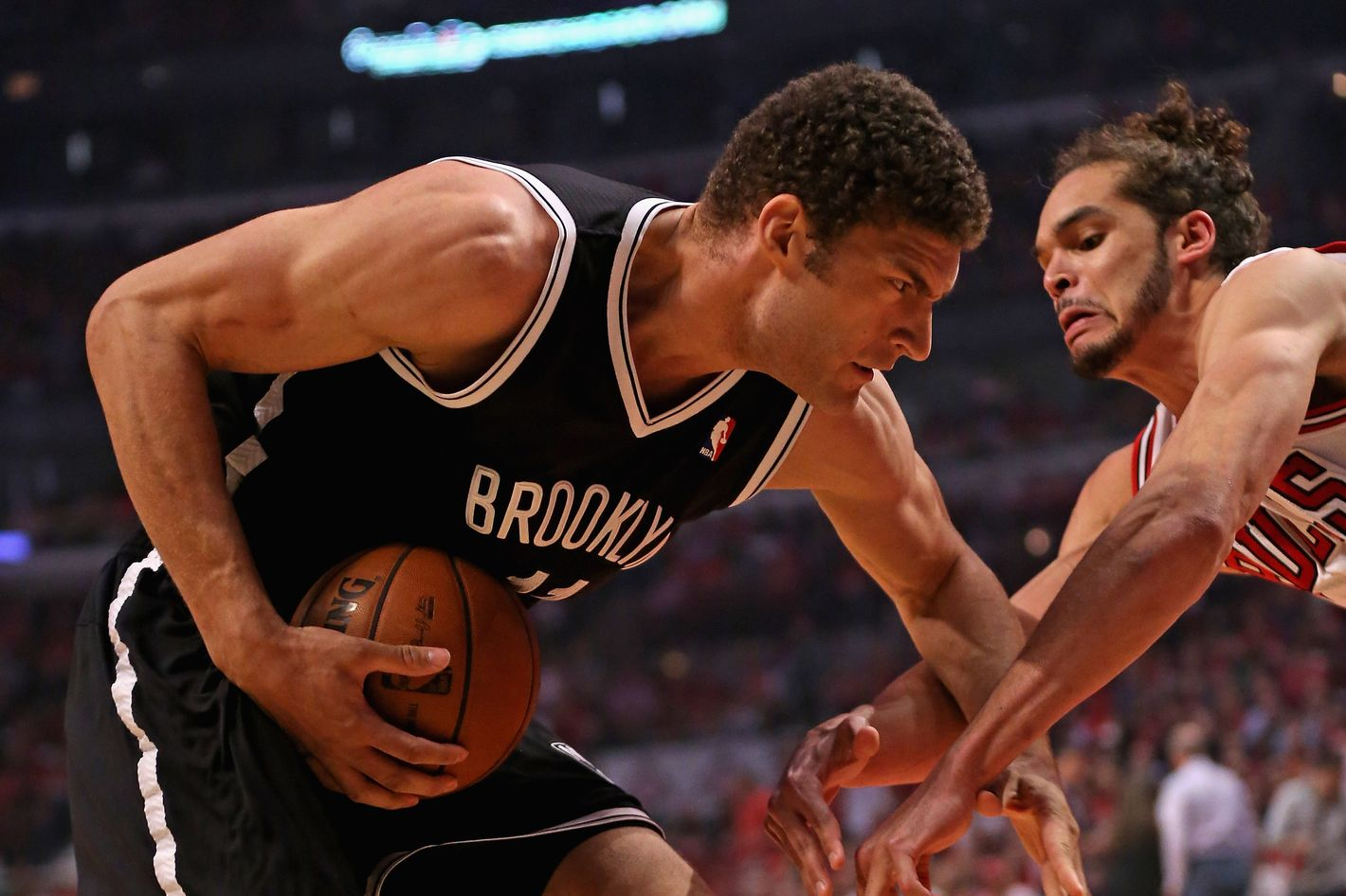 CHICAGO, IL - APRIL 27:  Brook Lopez #11 of the Brooklyn Nets moves against Joakim Noah #13 of the Chicago Bulls in Game Five of the Eastern Conference Quarterfinals in the 2013 NBA Playoffs at the United Center on April 27, 2013 in Chicago, Illinois. NOTE TO USER: User expressly acknowledges and agrees that, by downloading and/or using this photograph, User is consenting to the terms and conditions of the Getty Images License Agreement.  (Photo by Jonathan Daniel/Getty Images) *** Local Caption *** Brook Lopez; Joakim Noah