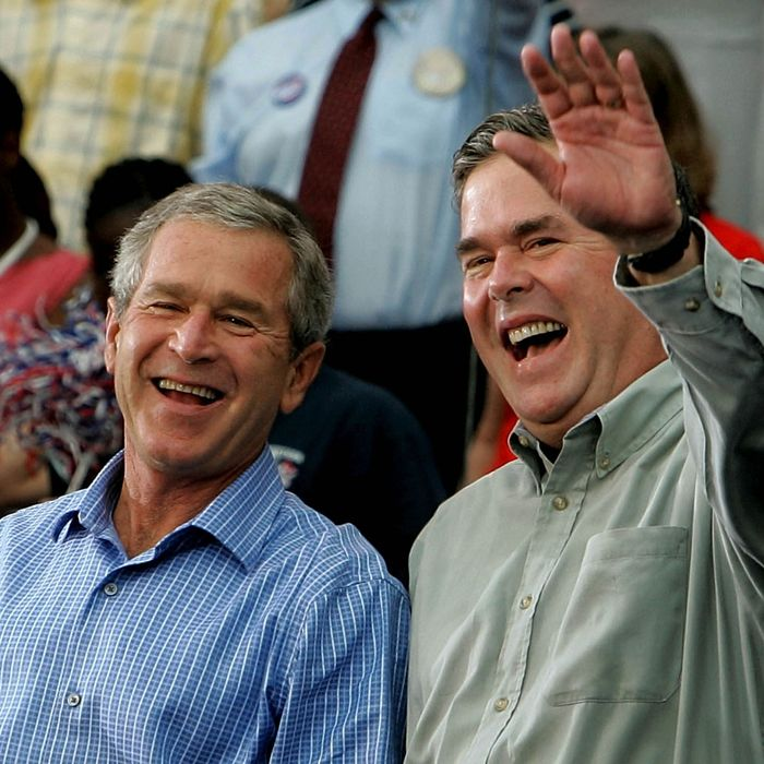 President Bush Campaigns In U.S. President George W. Bush (L) and his brother Florida Governor Jeb Bush (R) smile while greeting supporters during a campaign rally October 19, 2004 in St. Petersburg, Florida.