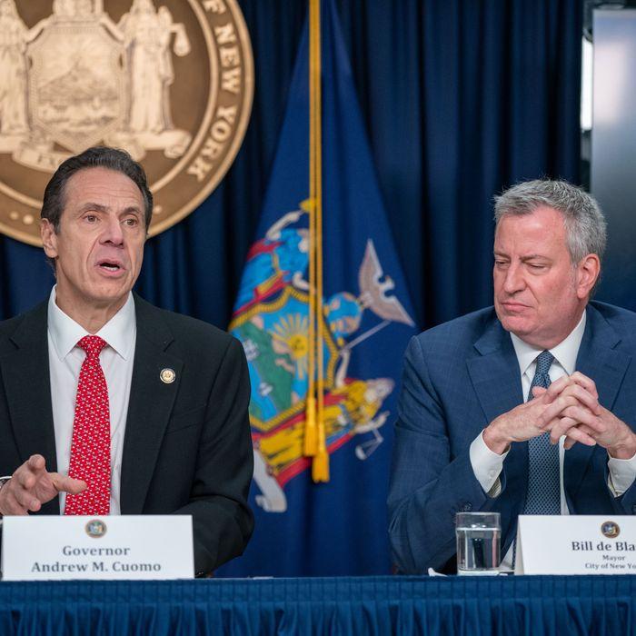 New York Governor Andrew Cuomo (left) and NYC Mayor Bill de Blasio (right).