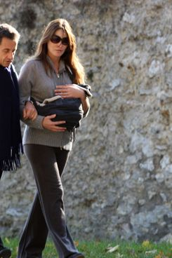 Nicolas Sarkozy, Carla Bruni-Sarkozy, and baby Giulia.
