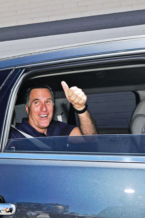 LOS ANGELES, CA - JULY 20:  Republican presidential candidate and former Massachusetts Gov. Mitt Romney gives a thumbs up after speaking to supporters in front of vacant stores of the Valley Plaza shopping center to a campaign stop on July 20, 2011 in Los Angeles, California.  Romney criticized President Barack Obama's handling of the economy during the brief campaign event.  (Photo by Kevork Djansezian/Getty Images)