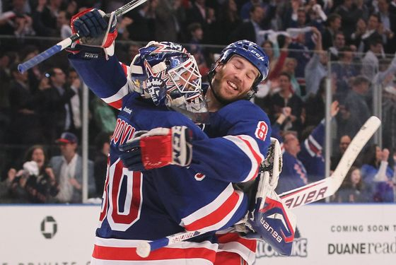 NEW YORK, NY - APRIL 26:  Henrik Lundqvist #30 and Brandon Prust #8 of the New York Rangers celebrate their 2 to 1 win over the Ottawa Senators in Game Seven of the Eastern Conference Quarterfinals during the 2012 NHL Stanley Cup Playoffs at Madison Square Garden on April 26, 2012 in New York City.  (Photo by Bruce Bennett/Getty Images)
