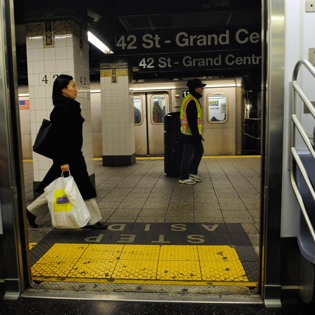 Commuters walks on a platform after disembraking from a train at a subway station in New York, November 21, 2008.  The New York Metropolitan Transportation Authorithy (MTA) said that to plug a 1.2 billion USD budget gap next year, it must increase fare and toll revenues by 23 percent, which would raise an additional 670 USD million if the increase goes into effect in early June. AFP PHOTO/Emmanuel Dunand (Photo credit should read EMMANUEL DUNAND/AFP/Getty Images)