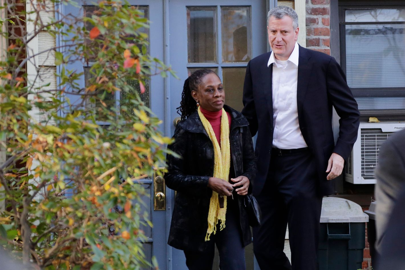 In this Nov. 6, 2013 photo, Chirlane McCray and her husband Bill de Blasio leave their house in the Park Slope neighborhood in the Brooklyn borough of New York. Now de Blasio faces a crucial early decision: should he leave Park Slope behind to move to the mayor's official residence, stately Gracie Mansion on Manhattan's Upper East Side?