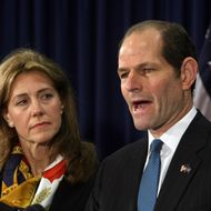 New York Governor Eliot Spitzer addresses the media with his wife Silda Wall at his office in New York, on March 12, 2008 to announce that he will resign from office after revelations that he had been a client of a prostitution ring. The resignation will take effect on March 17. Lieutenant Governor David Paterson will then take the office of governor.