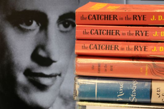 "FILE - In this Jan. 28, 2010 file photo, a photo of J.D. Salinger appears next to copies of his classic novel ""The Catcher in the Rye"" as well as his volume of short stories called ""Nine Stories"" at the Orange Public Library in Orange Village, Ohio. Salinger, died Jan. 27, 2010, in Cornish, N.H., at the age of  91. Letters written by Salinger to a spiritual mentor have been donated to the Morgan Library & Museum. The Morgan, based in Manhattan, announced Tuesday, April 9, 2013, that it will receive 28 letters by the author of ""The Catcher of the Rye."" The letters were written to  Swami Vivekananda, founder of the Ramakrishna-Vivekananda Center, which donated the correspondence. (AP Photo/Amy Sancetta, File)"