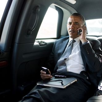PALM BEACH, FL - JULY 20: In this handout provided by The White House, President Barack Obama talks on the phone with Aurora Mayor Steve Hogan during the motorcade ride to Palm Beach International Airport July 20, 2012 in Palm Beach, Florida.. The President called Mayor Hogan to offer his condolences and support to the Aurora community. (Photo by Pete Souza/The White House via Getty Images)