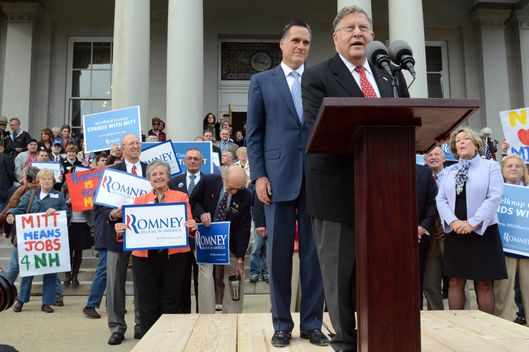 CONCORD, NEW HAMPSHIRE- OCTOBER 24:  Republican presidential candidate former Massachusetts Gov. Mitt Romney  listens as former New Hampshire Governor John Sununu endorses him for President outside the Statehouse October 24, 2011 in Concord, New Hampshire. Romney also filed the paperwork necessary to be on the New Hampshire primary ballot. (Photo by Darren McCollester/Getty Images)