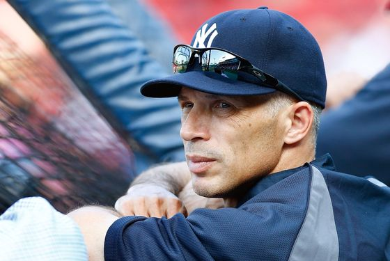 BOSTON, MA - JULY 06:  Manager Joe Girardi #29 of the New York Yankees watches his team hit during batting practice prior to the game against the Boston Red Sox on July 6, 2012 at Fenway Park in Boston, Massachusetts.  (Photo by Jared Wickerham/Getty Images)