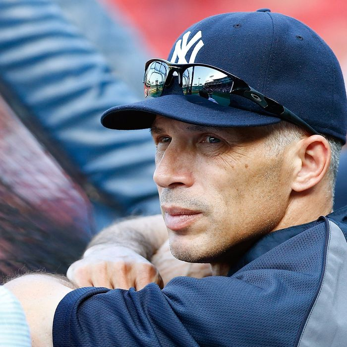 Manager Joe Girardi #29 of the New York Yankees watches his team hit during batting practice prior to the game against the Boston Red Sox on July 6, 2012 at Fenway Park in Boston, Massachusetts.