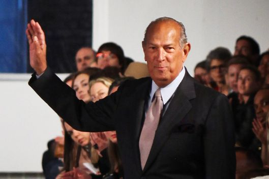 Designer Oscar de la Renta greets his audience after presenting the Oscar de la Renta 2012 Resort Collection show at a Private Studio on May 16, 2011 in New York City