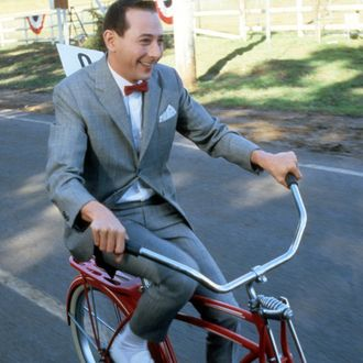 Paul Reubens rides a bike in a scene from the film 'Pee-Wee's Big Adventure', 1985. (Photo by Warner Brothers/Getty Images)