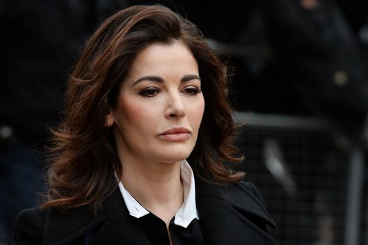 In this file picture taken on December 4, 2013 British television chef Nigella Lawson arrives at Isleworth Crown Court in west London, as she prepares to give evidence in a case in which her two personal assistants (Elisabetta and Francesca Grillo) are accused of defrauding her and former husband Charles Saatchi.