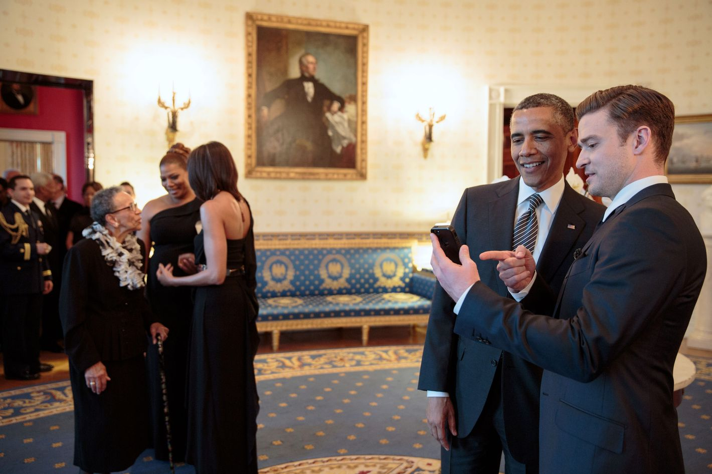 "President Barack Obama talks with performer Justin Timberlake in the Blue Room prior to the ""In Performance at the White House: Memphis Soul"" concert in the East Room of the White House, April 9, 2013."