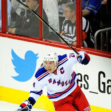 Ryan Callahan #24 of the New York Rangers celebrates after scoring thegame-winning goal in overtime against the Carolina Hurricanes during play at PNC Arena on April 25, 2013 in Raleigh, North Carolina. The Rangers won 4-3 in overtime.  (Photo by Grant Halverson/Getty Images)