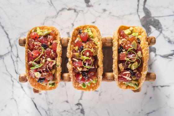 Tunapica tartare with crispy wonton, Spanish olives, currants, toasted coconut, almond, and avocado ceviche.
