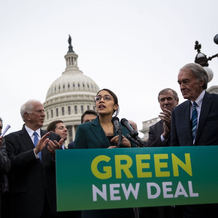 Representative Alexandria Ocasio-Cortez, a Democrat from New York, speaks as Senator Ed Markey, a Democrat from Massachusetts, right, listens during a news conference announcing Green New Deal legislation in Washington, D.C., U.S., on Thursday, Feb. 7, 2019.