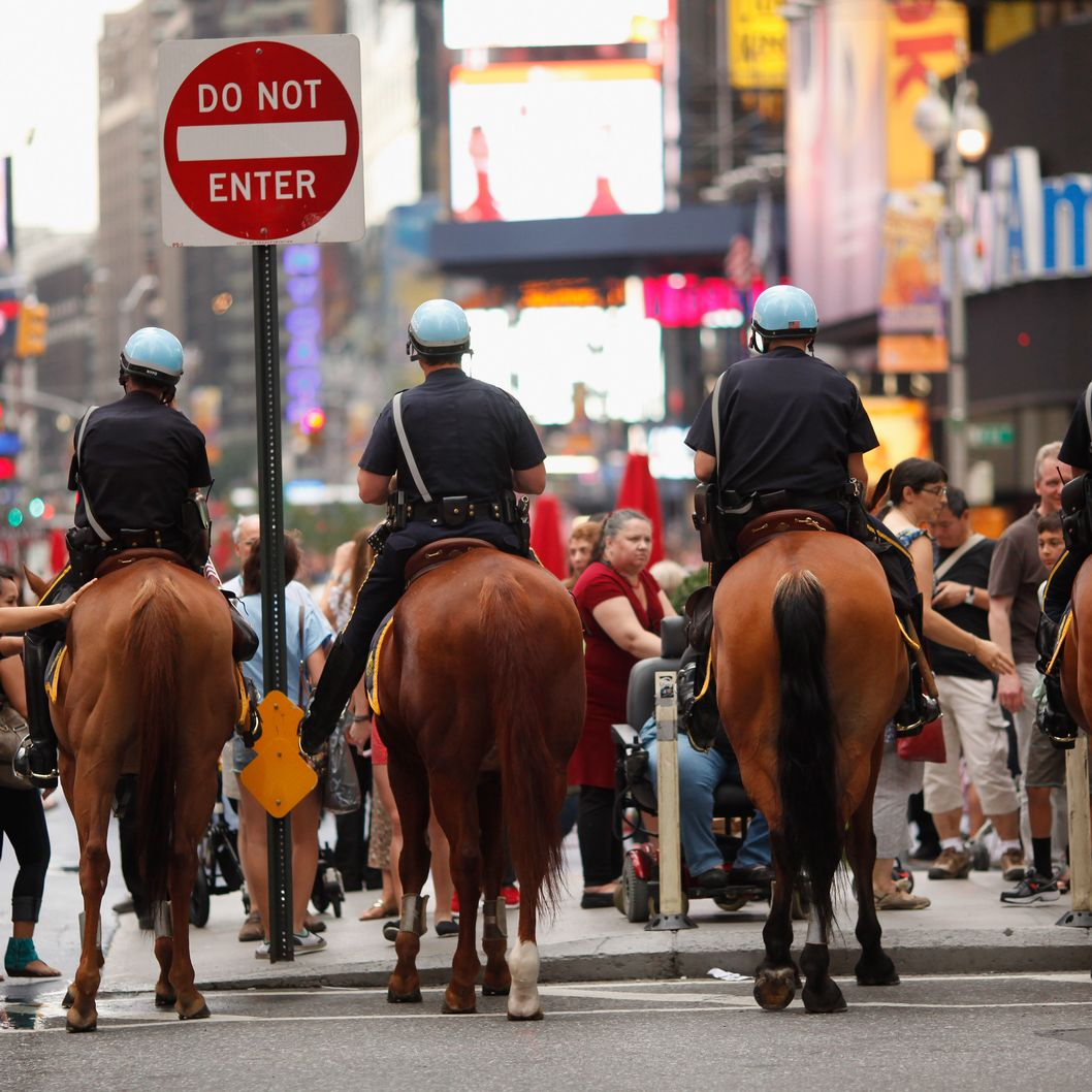 NEW YORK, NY - SEPTEMBER 10:  Mounted New York Police Department officers stand watch over Times Square on September 10, 2011 in New York City.  Law enforcement remains on high alert in New York and Washington D.C. after U.S. officials received a credible but unconfirmed terror threat to utilize car bombs on bridges or tunnels in New York or Washington.  (Photo by Chip Somodevilla/Getty Images)