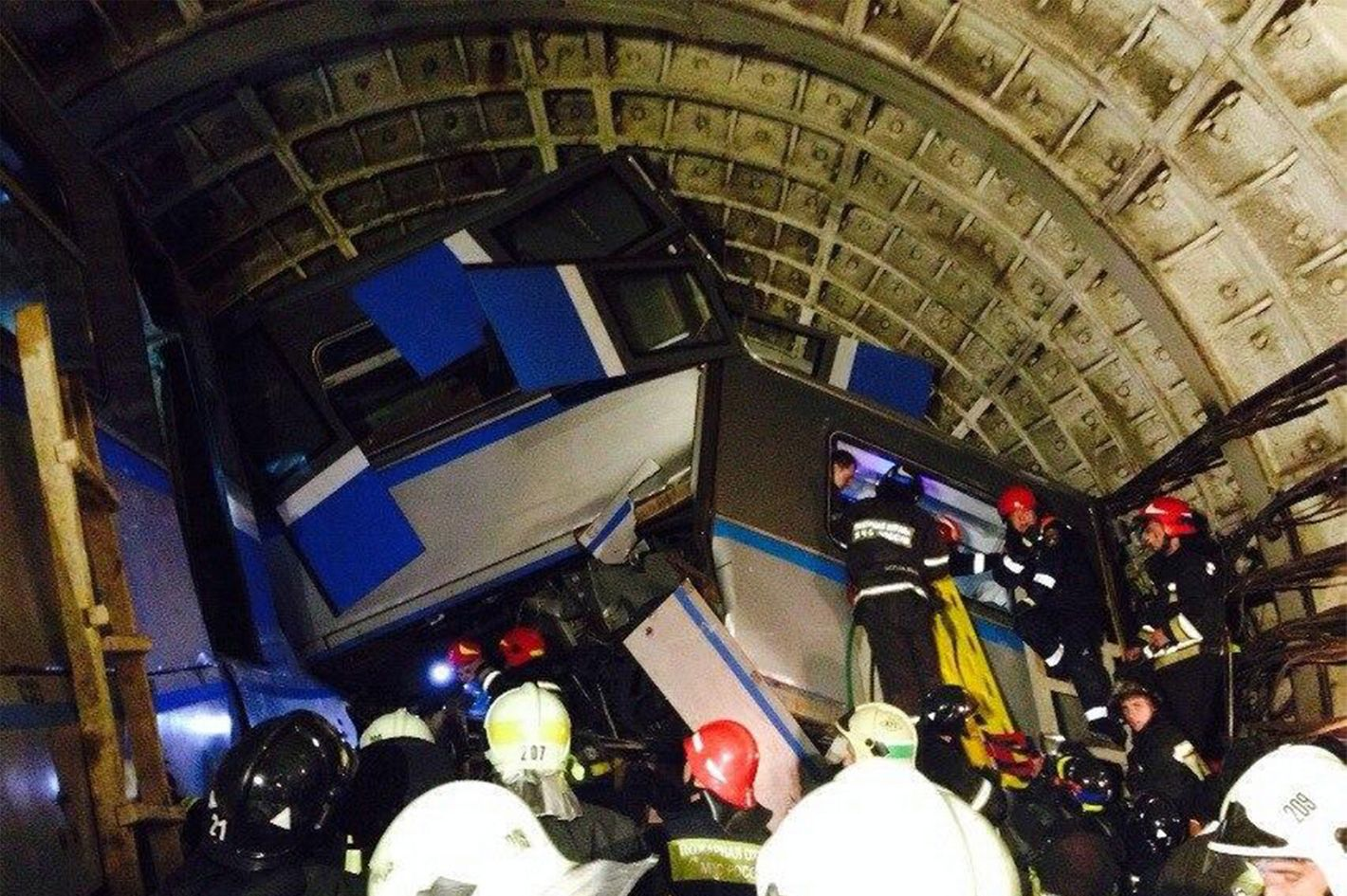 15 Jul 2014, Russia --- ITAR-TASS: MOSCOW, RUSSIA. JULY 15, 2014. At the site of a crash on the Moscow metro. Several cars derailed 200 meters away from Slavyansky Bulvar Metro Station. (Photo ITAR-TASS/ picture taken with a mobile phone/ Varya Valovil) --- Image by ? Valovil Varya/ITAR-TASS Photo/Corbis