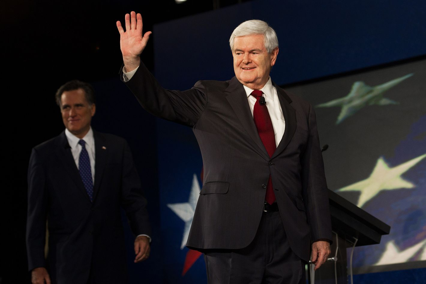 Republician presidential hopeful Newt Gingrich waves, followed by Mitt Romney, as they arrive to participate in the South Carolina Presidential Debate at Wofford College, sponsored by SCGOP, CBS News and the National Journal on November 12, 2011 in Spartanburg, South Carolina.   AFP PHOTO/Paul J. Richards (Photo credit should read PAUL J. RICHARDS/AFP/Getty Images)
