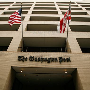 Flags wave in front of the Washington Post building on May 1, 2009 in Washington, DC. The newspaper has announced its first quarter earnings with a net loss of $19.5 million.