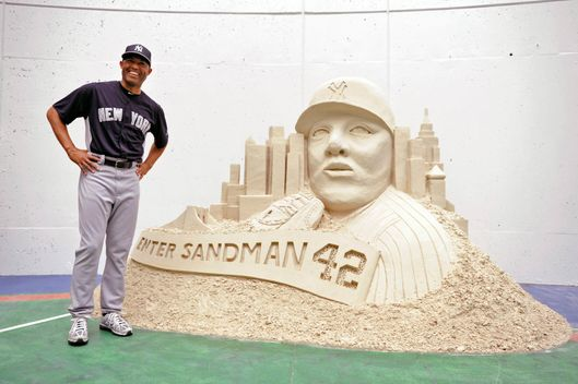 New York Yankees pitcher Mariano Rivera reacts as he gets his first look at a large sand sculpture presented to him by the Tampa Bay Rays as a retirement gift before the start of a Major League Baseball game in St. Petersburg, Florida, USA, 23 August 2013.