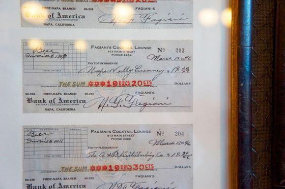 Some historic canceled checks, signed by Nick Fagiani in 1946, were found and framed for the walls of the bar.