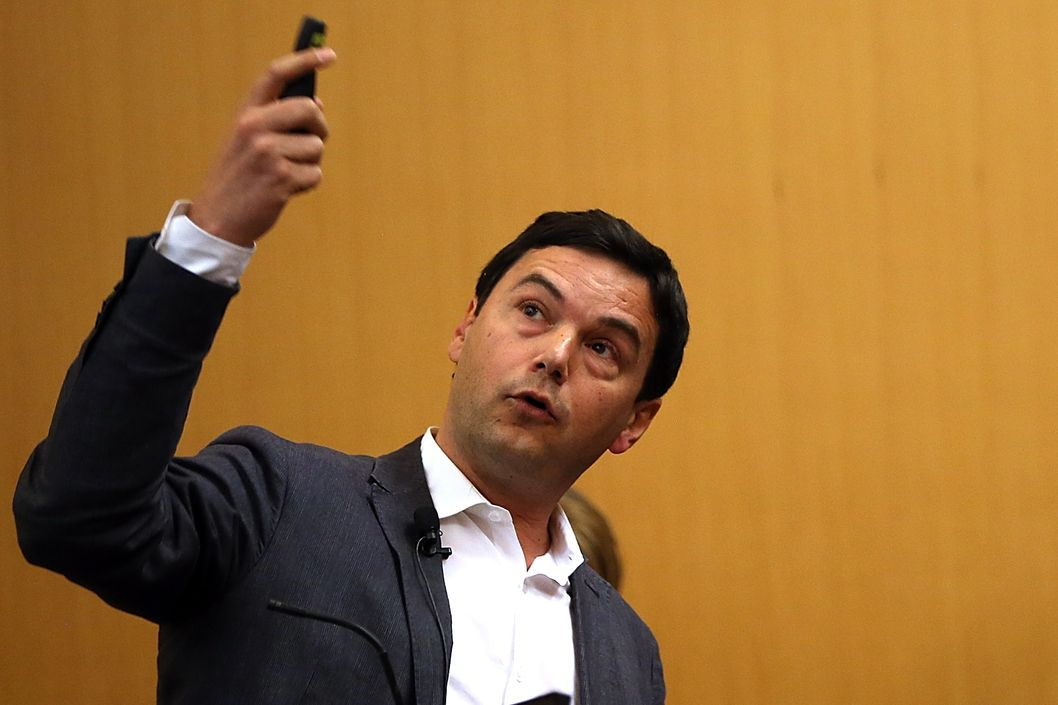 "BERKELEY, CA - APRIL 23:  Economist and author Thomas Piketty speaks to the Department of Economics at the University of California, Berkeley on April 23, 2014 in Berkeley, California.  Economist author Thomas Piketty gave a lecture about his best-selling book titled ""Capital in the 21st Century"" at UC Berkeley's Department of Economics. (Photo by Justin Sullivan/Getty Images)"