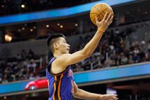Jeremy Lin #17 of the New York Knicks puts up a shot in front of Shelvin Mack #22 of the Washington Wizards during the first half at Verizon Center on February 8, 2012 in Washington, DC.