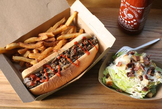 Whitman's cheesesteak with fries and a wedge salad.