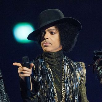 Prince presents an award at The BRIT Awards 2014 at The O2 Arena on February 19, 2014 in London, England.