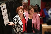 Democratic mayoral candidate Christine Quinn (L) and her wife Kim Catullo embrace after casting their votes in the primary election for New York City mayor on September 10, 2013 in New York City.  Quinn, trailing in the polls, is hoping to garner enough votes to compete in a runoff election to be the Democratic candidate.