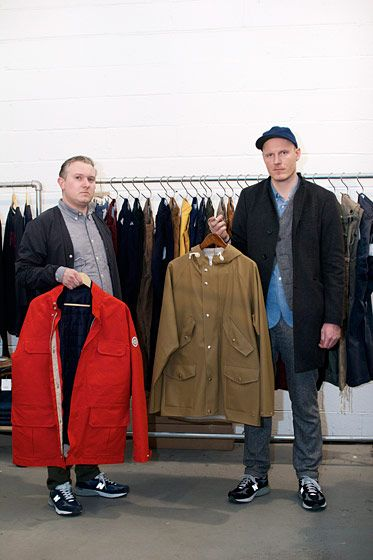 "Mikkel G: ""We live with cold, wet and windy weather most of the year, so knitwear, heavy jersey and outerwear play a big role for us. Here's a classic M65 inspired jacket that comes with a removable quilted inner bomber jacket, made of windproof ripstop nylon. The outer layer is made from an extremely heavy, tight knitted cotton made by one of Scotland's finest fabric suppliers. You can wear them together or separately.""  Mikkel K: ""This is a 4-pocket rain parka, made from 100% PVC. It's 100% rain and windproof, all made in Europe."""