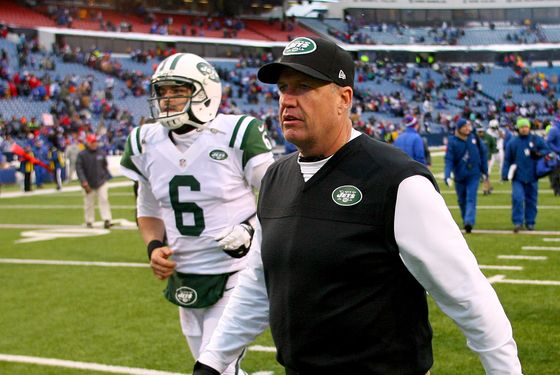 Head coach Rex Ryan and Mark Sanchez #6 of the New York Jets walk off the field after losing to the Buffalo Bills 28-9 at Ralph Wilson Stadium on December 30, 2012 in Orchard Park, New York.