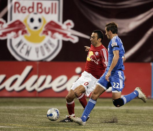 East Rutherford, UNITED STATES:  New York Red Bulls forward Youri Djorkaeff (L) from Lyon, France vies for the ball with Kansas City Davy Arnaud during the last game of the regular MLS (Major League Soccer) season against the Kansas City Wizards at Giants Stadium in East Rutherford, New Jersey 14 October 2006. Djorkaeff, who would have played the last game of his career if his team had lost, secured a playoff spot next week with a 3-2 win. AFP PHOTO  Timothy A. CLARY  (Photo credit should read TIMOTHY A. CLARY/AFP/Getty Images)