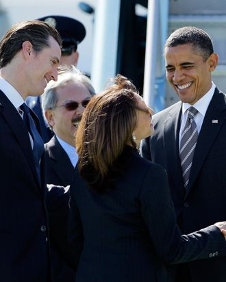 President Barack Obama is greeted by, from left, California Lt. Gov. Gavin Newsom, San Francisco Mayor Ed Lee and California Attorney General Kamala Harris upon his arrival at San Francisco International Airport in San Francisco, Thursday, Feb. 16, 2012. President Obama is spending the night in San Francisco attending a number of private fundraising events. (AP Photo/Eric Risberg)